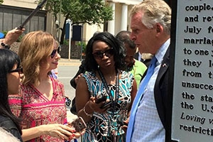 Leena Jayaswal (left) and Caty Borum Chattoo talk with VA Governor Terry McAuliffe (right)