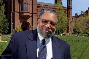 Lonnie Bunch in front of the Smithsonian Castle.