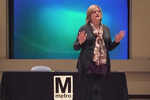 Lynn Bowersox speaking at a Metro event