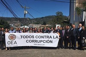 Group holding anti-corruption sign
