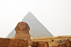 The Sphinx with Pyramid in the background.