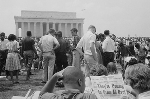 A crowd of African American and white people on the grounds of the Lincoln Memorial on August 28, 1963.