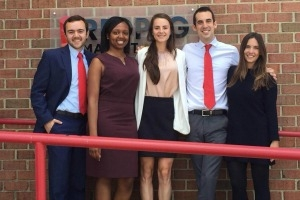 MS Marketing students stand outside marketing agency after their final class presentations.