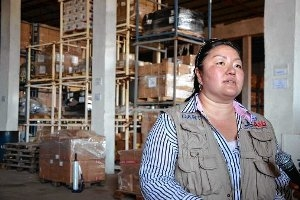 Mia Beers speaks at a warehouse with supplies to fight Ebola.
