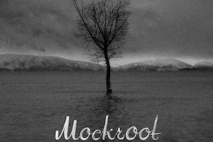 Black and white tree without leaves in front of mountains. Text reads Mockroot