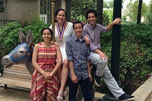 Four Preston children pose on campus at AU.