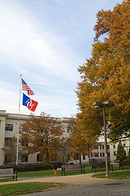 Picture of flagpole on the Quad with the AU and American flags waving in the wind