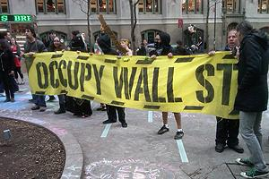 AU researchers observe Occupy Wall Street participant demonstrating peaceably. Photo: Ed Maguire