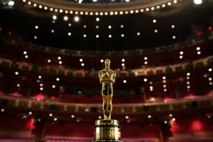 An Academy Award against the backdrop of a theater and theater lights