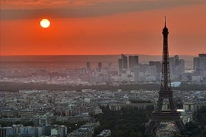 Sunset behind Eiffel Tower in Paris, France