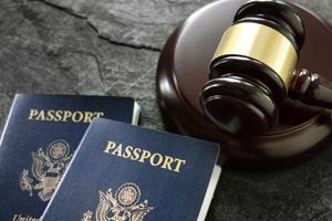 Two passports and a gavel