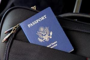 A United States passport in the pocket of a suitcase.