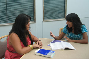 Alicia Mandac, CAS Academic Counselor and Peer Program Supervisor advising a student