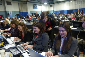Making news: Elise Tollefson in the press filing room at the first New Hampshire GOP debate.