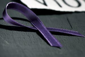 The purple ribbon for domestic violence prevention.