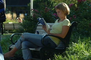 Female reading on a bench