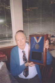 Richard L. Schlegel holding the award named in his honor