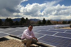 Rohan Shah next to sustainable solar energy alternatives.