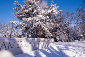 American University sign covered in snow