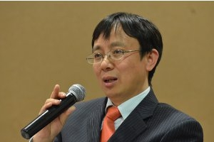 Wu Xinbo, associate dean, School of International Relations and Public Affairs, Fudan University in China speaks at the symposium