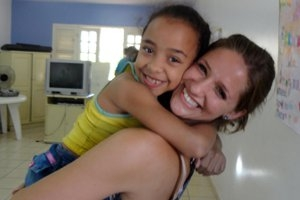 Christina Phillips, SIS/MA '12, and a friend at her internship with <i>Projeto Criança Feliz</i>, or the Happy Child Project, in Brazil.