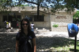 Alumna Nicole Dionne, SIS/BA '07, poses in front of the Hopital Albert Schweiter Haiti. Photo courtesy of Nicole Dionne.
