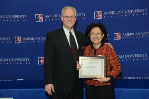 Professor Pek Koon Heng received the Outstanding Faculty Award from University Honors Program Director Michael Manson.