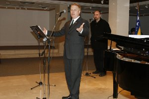 "Ron Hawkins, SIS/BA '95, SIS/MA '97, introduces the American Embassy program ""Excerpts from <i>Porgy and Bess</i>"" in Mostar, Bosnia-Herzegovina. Photo courtesy of Ron Hawkins."