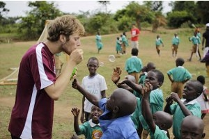 Tyler Steinhardt, SIS/BA'15, in Masaka, Uganda with students from the HOPEFUL School.