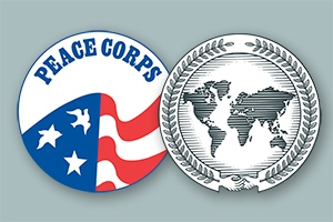Vintage Peace Corps seal floats behind School of International Service seal.