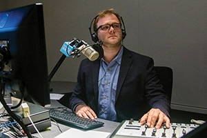 WAMU's Patrick Madden broadcasting from his desk