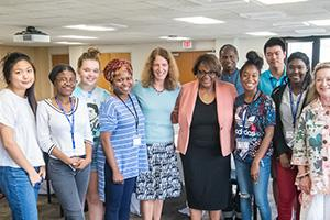 AU's first cohort of DCPS Dual Enrollment Students Poses with AU President Sylvia Burwell.