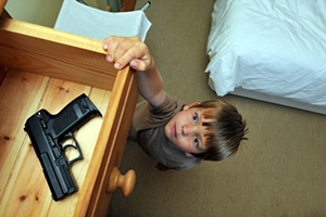 Young child (4-6) reaching for a handgun