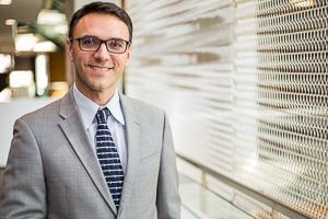 SPExS Associate Dean of Graduate Professional Studies in a grey blazer.