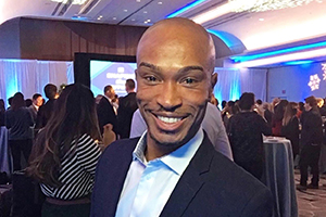 Shawn Richardson smiles for an event photo