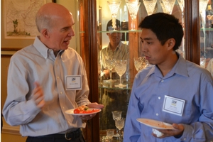 SIS IER Photo of Dr. Stephen Silvia talking to student Alex Choy.