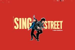 Sing Street a new musical two people on a red background, one is holding a guitar