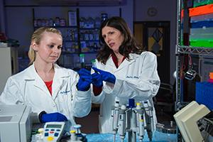 Professor and student working in lab.