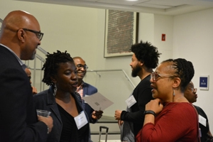 Kogod professor Sonya Grier (right) talking with colleagues at the 2017 Race in the Marketplace Forum.