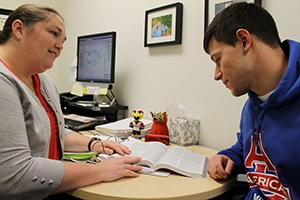 Breslin (left) and swimmer Volaski discuss spring courses. Photo by Patrick Bradley.