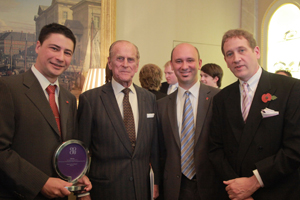 The authors and publisher accept the award from the Duke of Edinburgh.