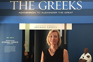 Professor Stogner in front of the The Greeks Exhibit at National Geographic