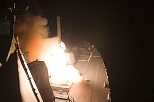 The U.S. Navy guided-missile destroyer USS Arleigh Burke (DDG-51) launches RGM-109 Tomahawk cruise missiles.