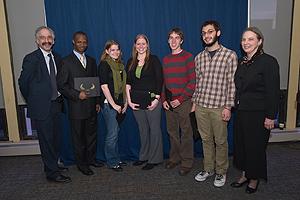 Honors Program Director Michael Mass, left, and associate director Paula McCabe, far right, with the oustanding seniors, from left: Hamissou Samari, Molly Kenney, Katie Beran, Jacob Shelly, and Andrew Wolf. (Photo: Jeff Watts)