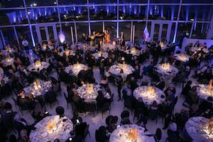 Many elegant tables with fancy lighting.
