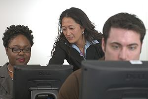Instructor assisting students in computer lab