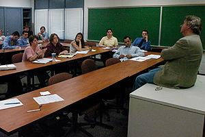 Graduate students and professor sitting in classroom