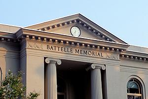 Photo of the front of the Batelle-Tomkins Memorial Building, the home of the School of Communication at American University