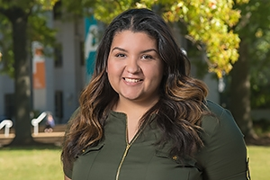 Student trustee Valentina Fernández on the Quad in front of Ward Circle Building.