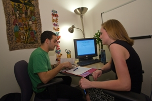 Students discussing a paper in the writing lab